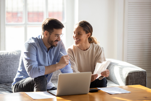 couple applying for an online loan at home from their laptop